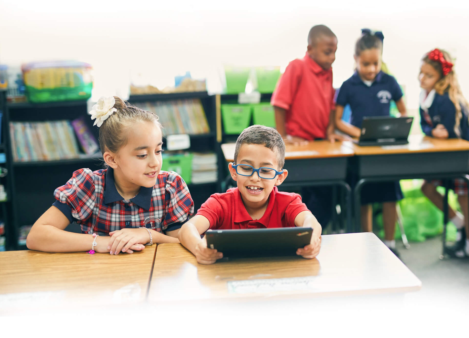 Students at Rainbow Christian Academy using their tablets in the classrom to learn